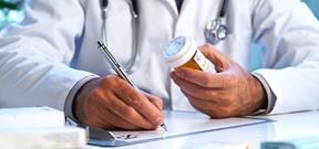 Medical Doctor Writing A Prescription